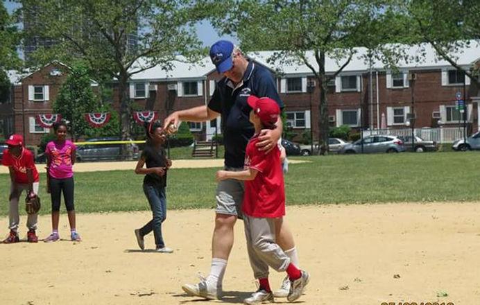 Man with children on baseball field