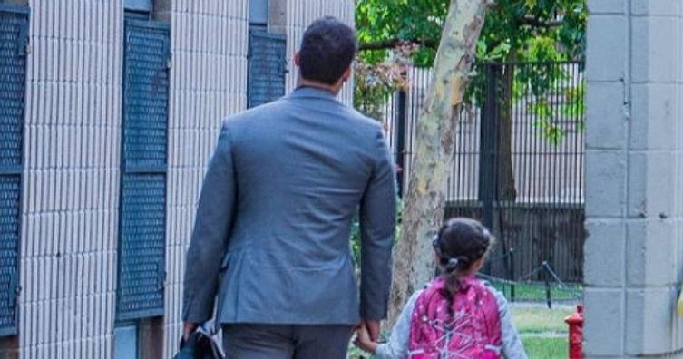 Man walking child to school