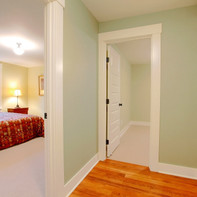 Hallway near bedroom with red bed.jpg