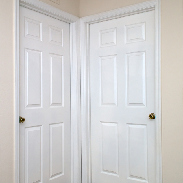 View of two white interior doors closed
