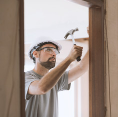 carpenter-installing-a-door-jamb-at-home