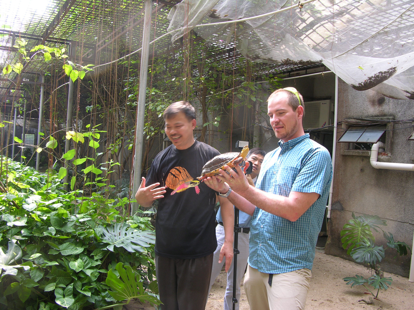 Li Yi & Torsten Blanck at Li Yis Golden Coin Turtle Farm