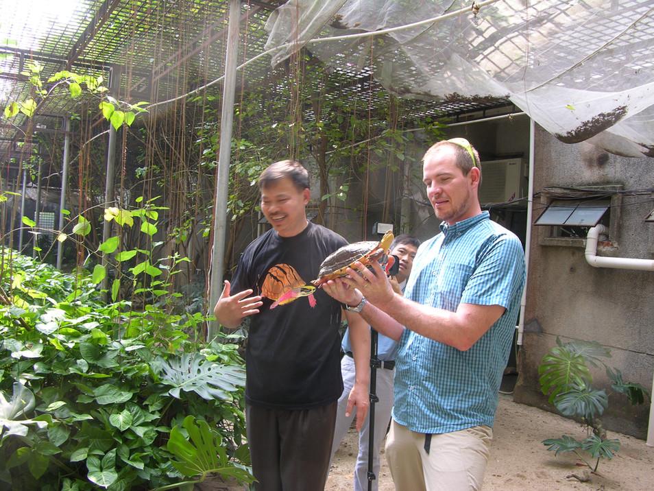 Li Yi & Torsten Blanck at Li Yis Golden Coin Turtle Farm