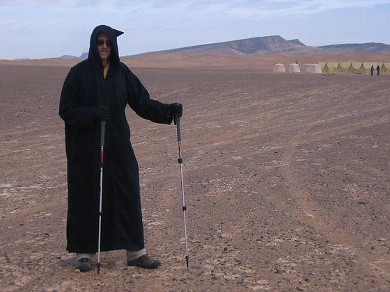 dave with trekking poles in desert.JPG