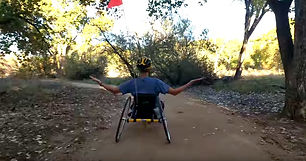 dave on a trail in NM with handcycle.jpg