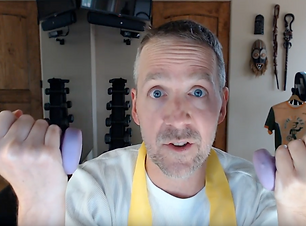 dave with hand weights.png