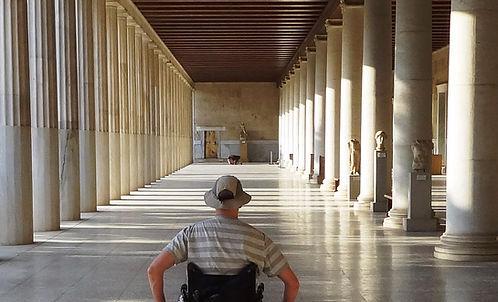 david in a wheelchair with columns.jpg