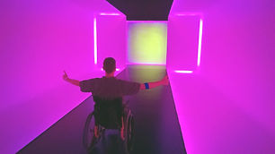 dave in a purple tunnel in a wheelchair.