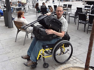 dave in a wheelchair with two suitcases