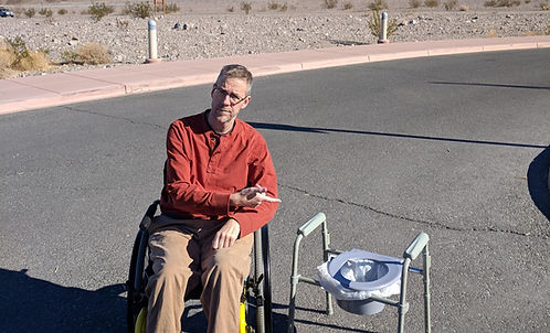 dave outside with bedside commode.jpg