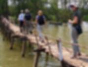 laura on a rickety bridge in vietnam.jpg
