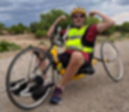 Dave Bexfield, founder of ActiveMSers, flexing muscles on his arm trike