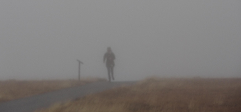 person running in rain and wind
