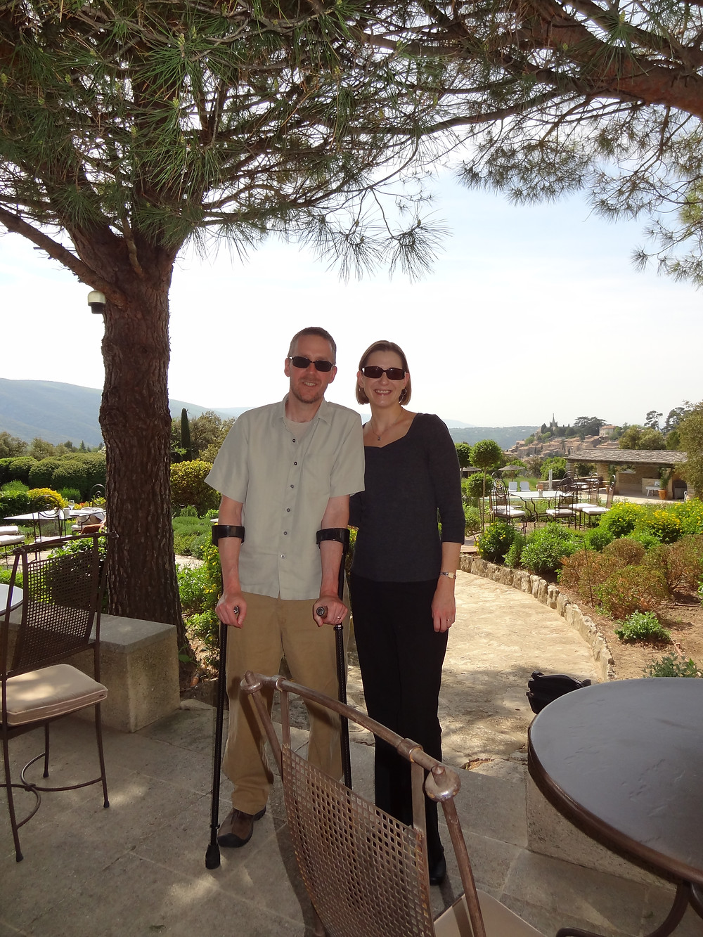Man with forearm crutches and woman in French vineyard