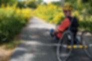 Dave biking with sunflowers.jpg