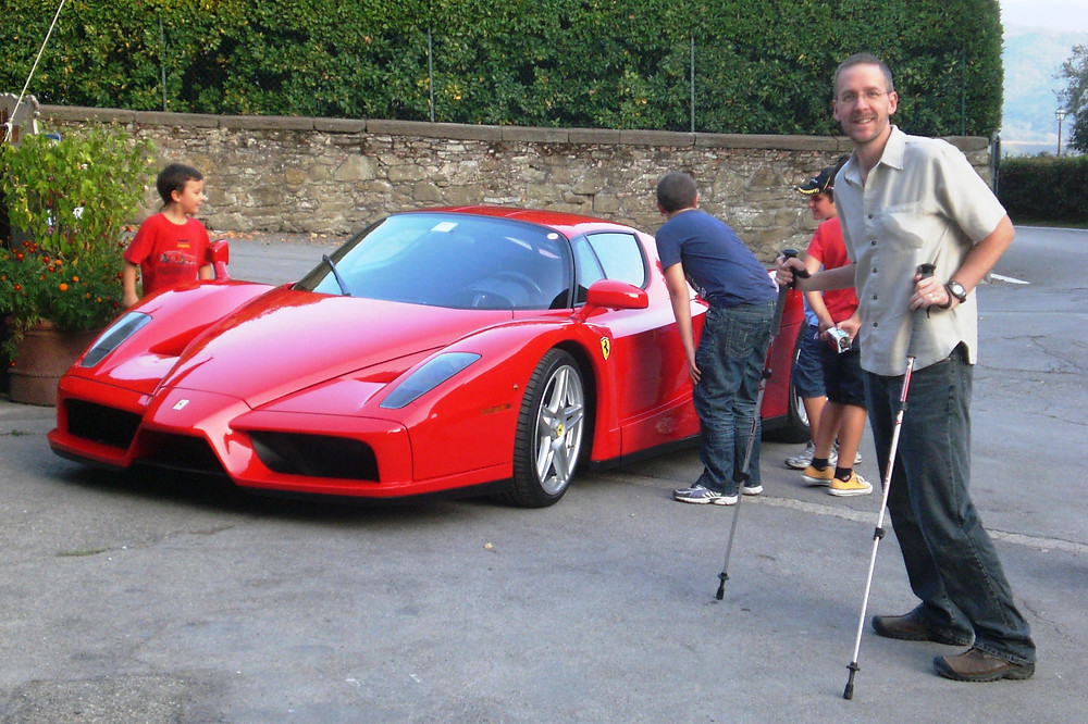 Ferrari Enzo in Italy with Dave using trekking poles