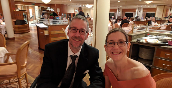 dave and laura dining on a cruise ship.j