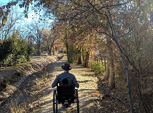 Dave in off road wheelchair on dirt trai