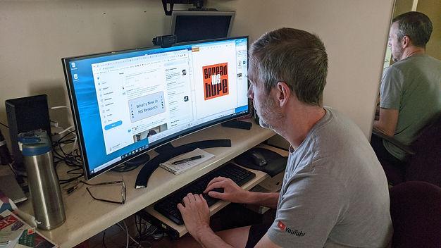 dave reading online newsletter.jpg
