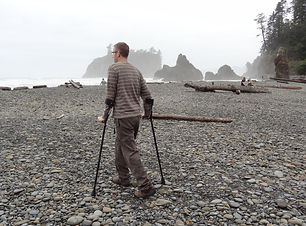 dave walking on a rocky beach with forea