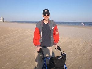 dave with a walker on the beach.jpg