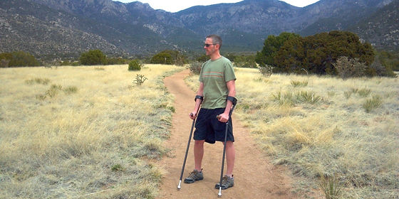 dave on a trail with forearm crutches.jp