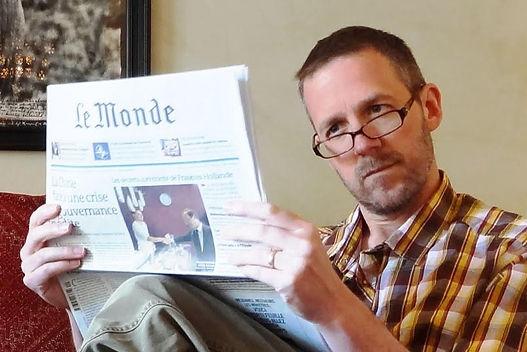 dave reading newspaper.jpg