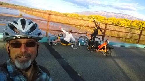dave biking with friends.jpg