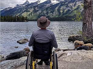 Dave in a wheelchair overlooking a lake