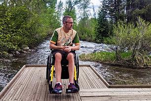 dave in a wheelchair by a stream.jpg