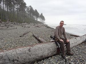 dave on beach with forearm crutches.JPG