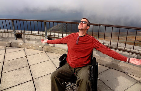 dave in a wheelchair on a patio.JPG