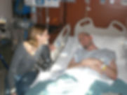 Caregiver Laura with Dave in hospital be