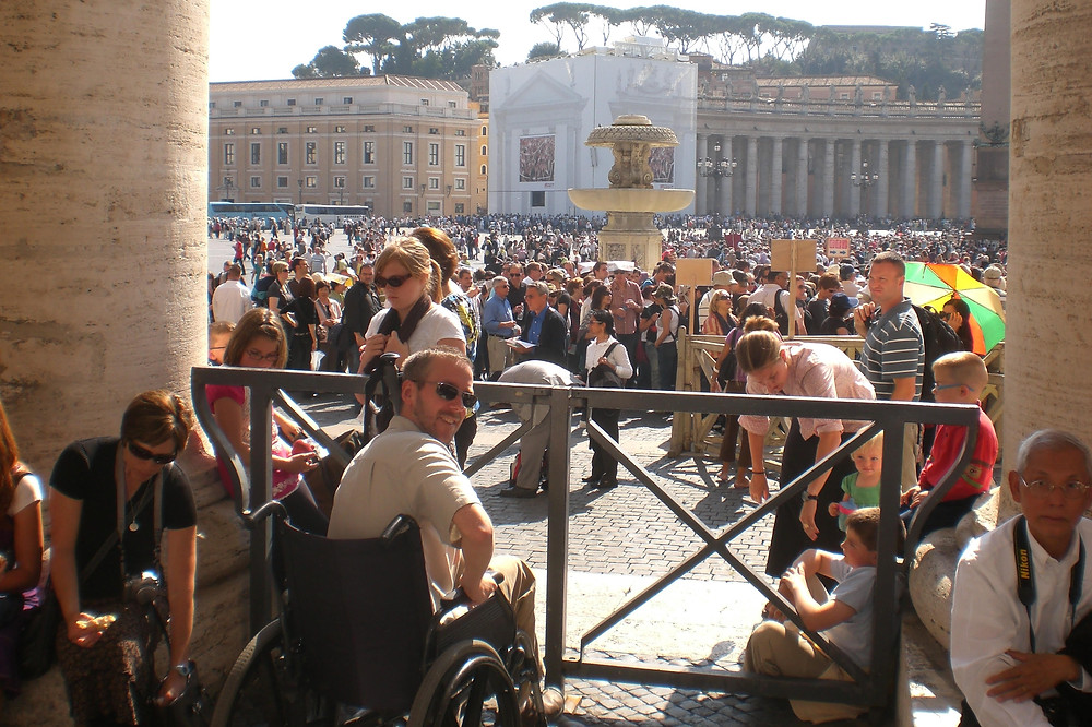 Dave in a wheelchair at the Vatican, borrowed from the Italian MS Society