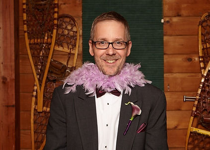 dave in a tux with a pink boa.jpg