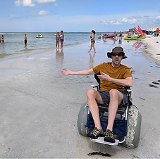 Dave in a floating beach wheelchair at C