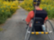dave in arm trike on a trail surrounded