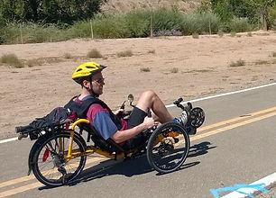 dave riding down road on trike.jpg