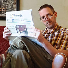 Dave reading Le Monde newspaper.jpg