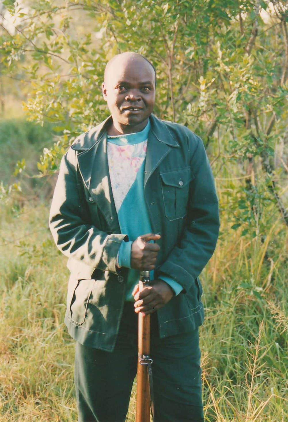 Kenyan man with buffalo rifle