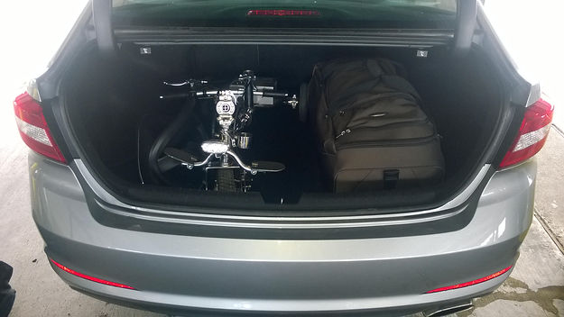 travel scooter in trunk of car.jpg