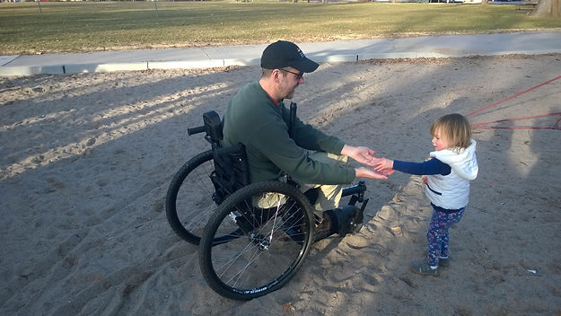 dave in offroad wheelchair with niece.jp