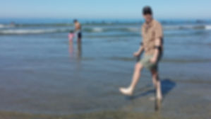 Dave at the beach using forearm crutches