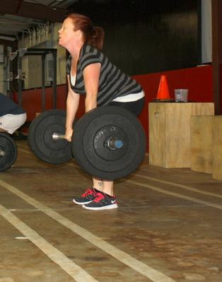 Woman with MS doing CrossFit dead lift