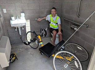 Dave in a park bathroom with arm trike.j
