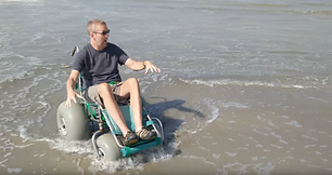 Dave in a beach wheelchair.png