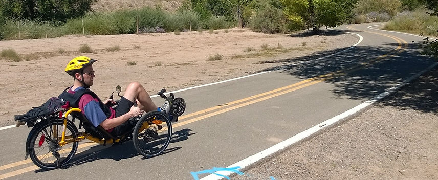 dave riding down a road on a trike.jpg