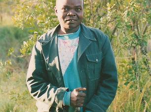 kenyan with buffalo rifle.jpg