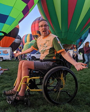Dave Bexfield of ActiveMSers at Albuquerque Balloon Fiesta in a wheelchair