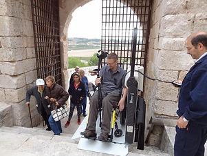 dave in wheelchair lift in europe.jpg